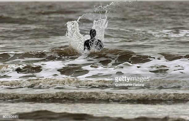 One of the lifesize body cast statues of 'Another Place' created by the artist Antony Gormley stands up to the spring tide on Crosby beach March 13...