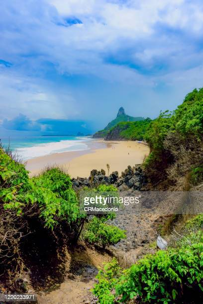 one of the longest beaches in fernando de noronha, is a must go in the island, especially for surfers. - crmacedonio stock-fotos und bilder