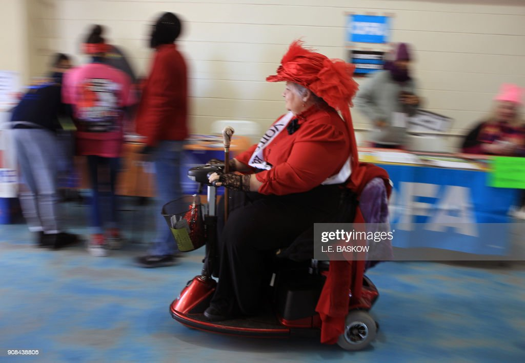 TOPSHOT - One of the many ADA participants moves along at the Women's March Anniversary 'Power To The Polls' event, January 21, 2018 at Sam Boyd Stadium in Las Vegas, Nevada. - The rally is aimed at starting a national campaign to register voters, increase support for women and secure progressive seats in the upcoming midterm elections.