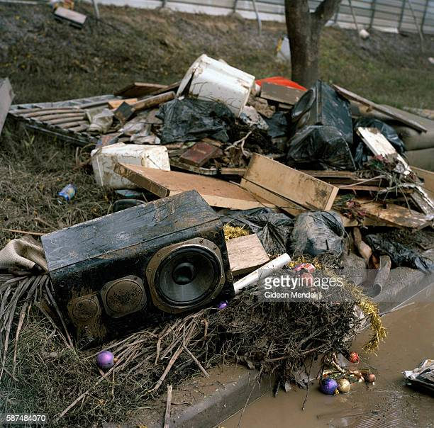 One of the many piles of flood damaged household good and possessions which became a fixture on all the pavements in the flood ravaged districts of...