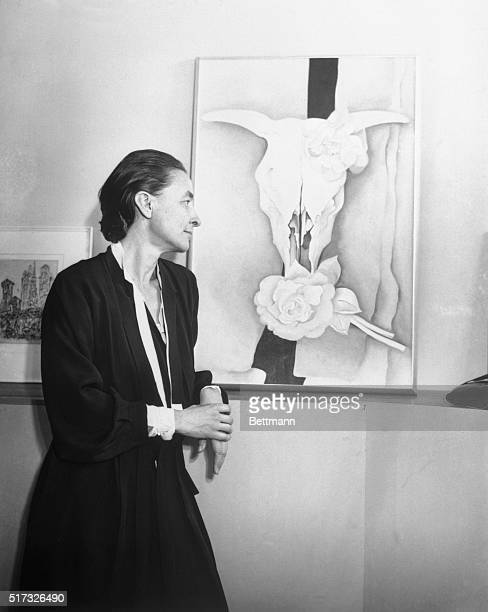 One of the many remarkable combinations of bleached bones and lovely blooming flowers produced by the fertile brain of Miss Georgia O'Keeffe the...