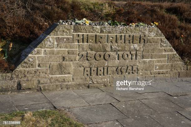One of the mass graves at the former BergenBelsen German Nazi concentration camp in Lower Saxony Germany 2014 The sign reads 'Here Rest 2500 dead...