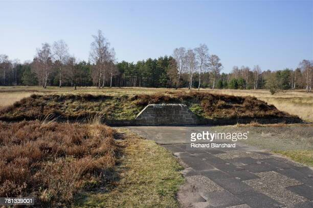 One of the mass graves at the former BergenBelsen German Nazi concentration camp in Lower Saxony Germany 2014 The sign reads 'Here Rest 1000 dead...