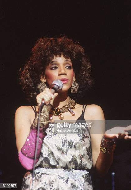 One of the members of the soul disco group Sister Sledge on stage at the Hammersmith Odeon in London
