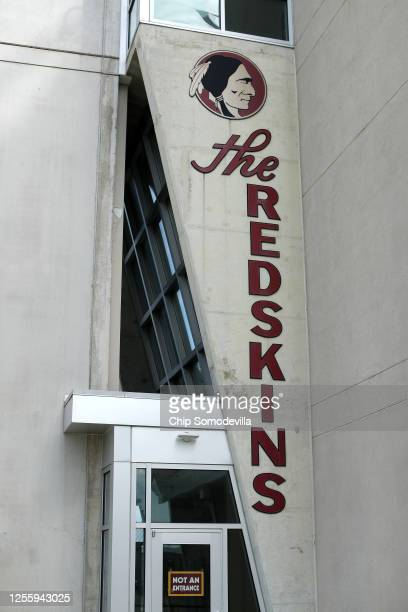 One of the metal signs from the NFL's Washington Redskin's original 1937 offices in Washington now adorns a wall on the outside of FedEx Field July...