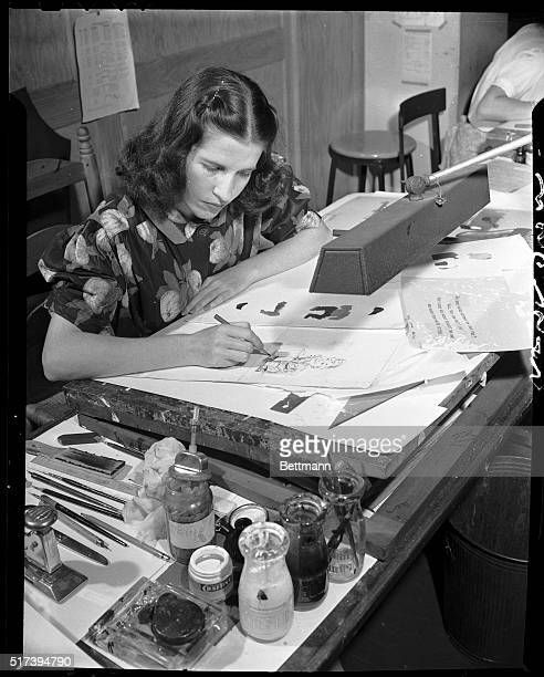 11/1/1942 One of the most difficult processes in the making of the Christmas card is that of color reproduction This artist uses a separate plate for...