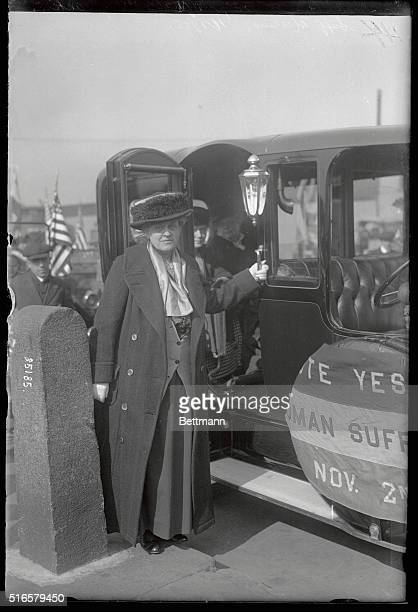 One of the most prominent of the New York Suffragist photographed in battery park just before the start of the flying squadron of sixty automobiles...