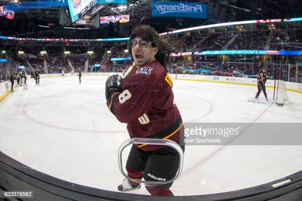 One of the Mullet Brothers the Cleveland Monsters Ice Crew charges the photo hole during the third period of the AHL hockey game between the Chicago...