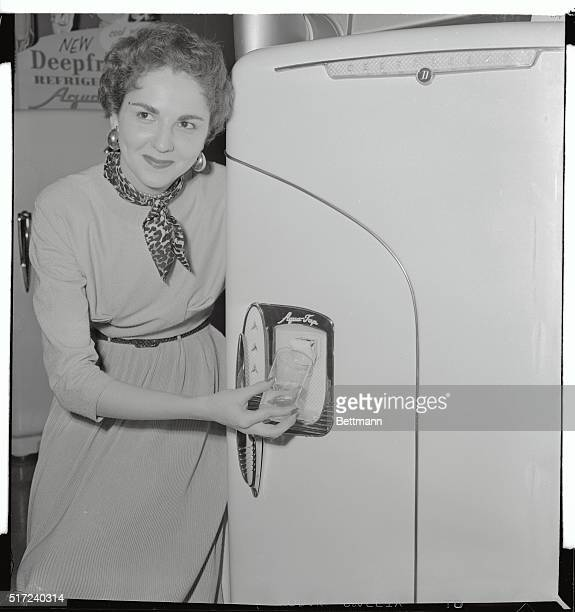 One of the new ideas to make life simpler in this hustlebustle world is the Aquatap for your refridgerator door Here a lovely lady at the Chicago...