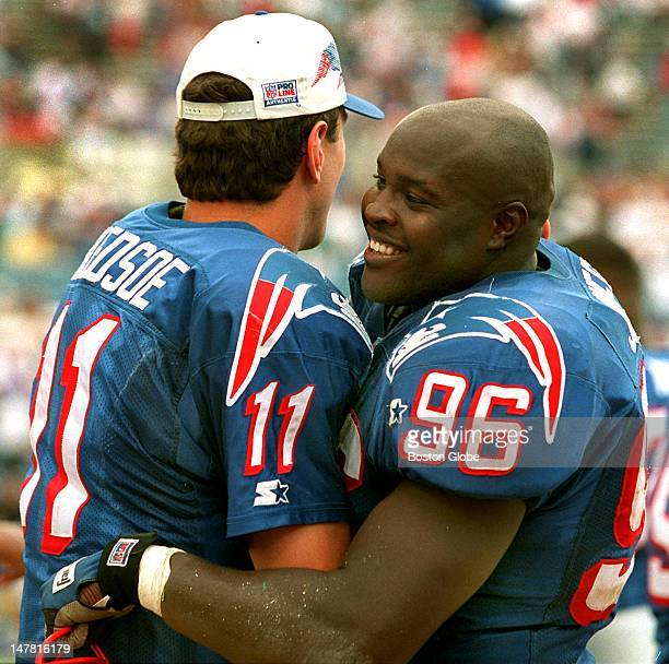 One of the offensive stars of the game QB Drew Bledsoe and one of the defensive stars Mike Jones embrace on the sidelines as time winds down in the...