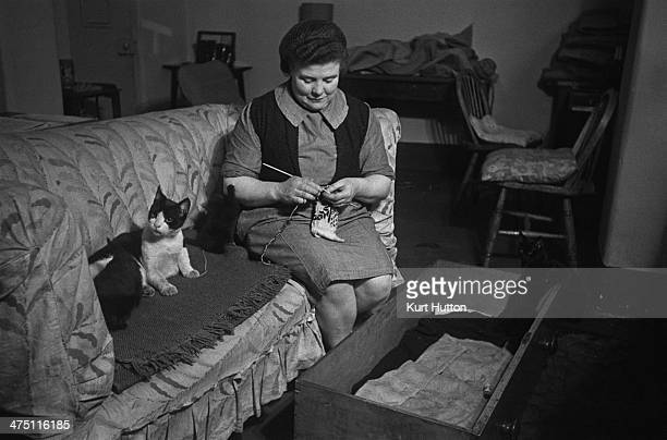 One of the older prisoners with her pet cats in her cell at Holloway Prison north London March 1947 Having completed penal servitude she is now...