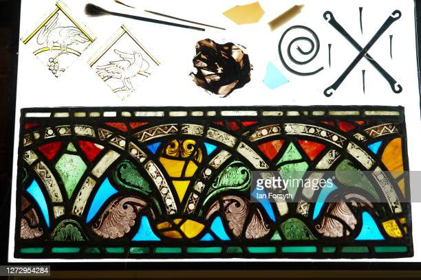 One of the oldest stained glass panels in Europe is displayed at a media preview of a new exhibition showcasing treasures from York Minster's...