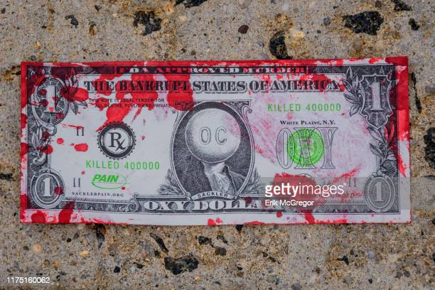 One of the Oxy Dollars thrown outside the courthouse Members of PAIN and Truth Pharm staged a rally and diein outside New Yorks Southern District...
