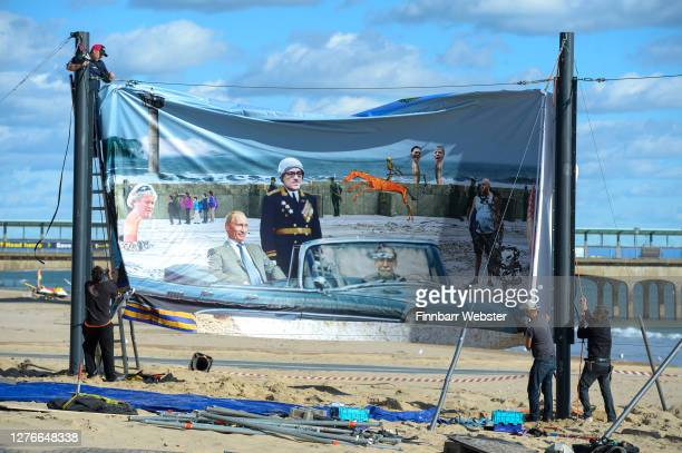 One of the panels that is to be censored is put into place on Boscombe beach on September 25, 2020 in Bournemouth, England. The satirical artist Cold...
