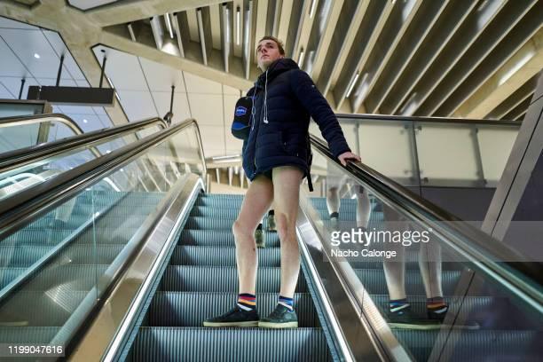 One of the participants climbs the subway stairs during the No Pants Subway Ride on January 12, 2020 in Amsterdam, Netherlands. The 19th edition of...
