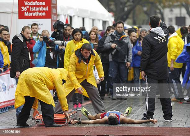 One of the participants faints during 36th Vodafone Istanbul Marathon in Istanbul Turkey on 16 November 2014 Participants from 118 countries attend...