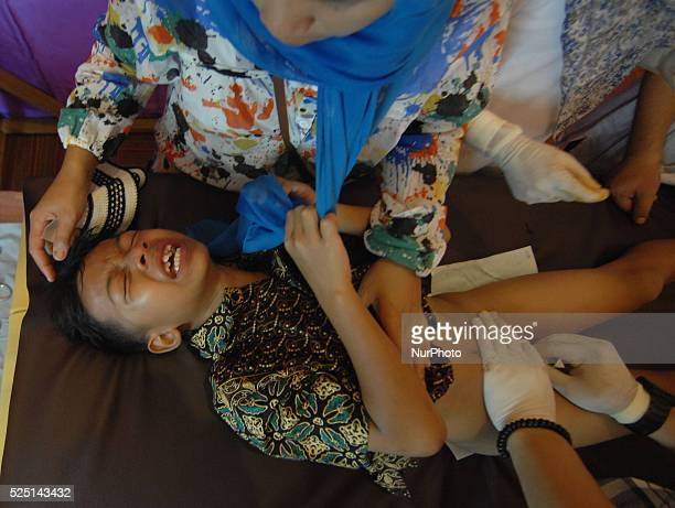 One of the participants shouted in pain when doctors perform circumcision held by the mosque committee Attin Taman Mini Indonesia Indah Indonesia on...