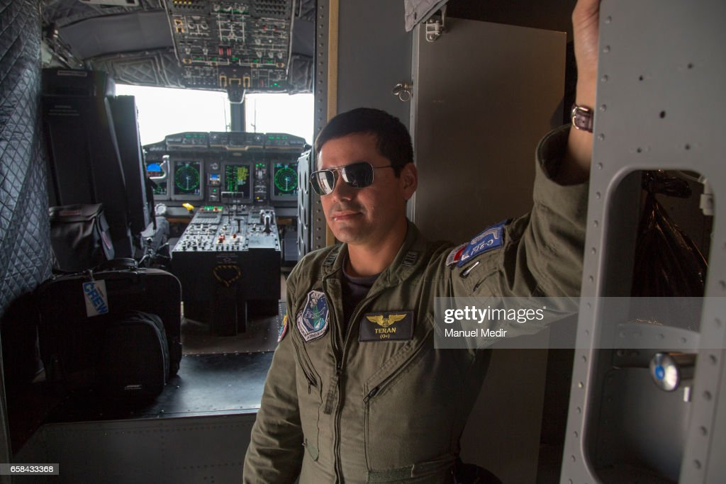 One of the pilots stands inside a C27-J Spartan plain with flood victims from the North of Peru at Callao airport on March 27, 2017 in Callao, Peru. El Nino is causing severe storms since the begining of the rainy season in Peru now leaving more than 80 dead and at least 111,000 affected all over the territory.