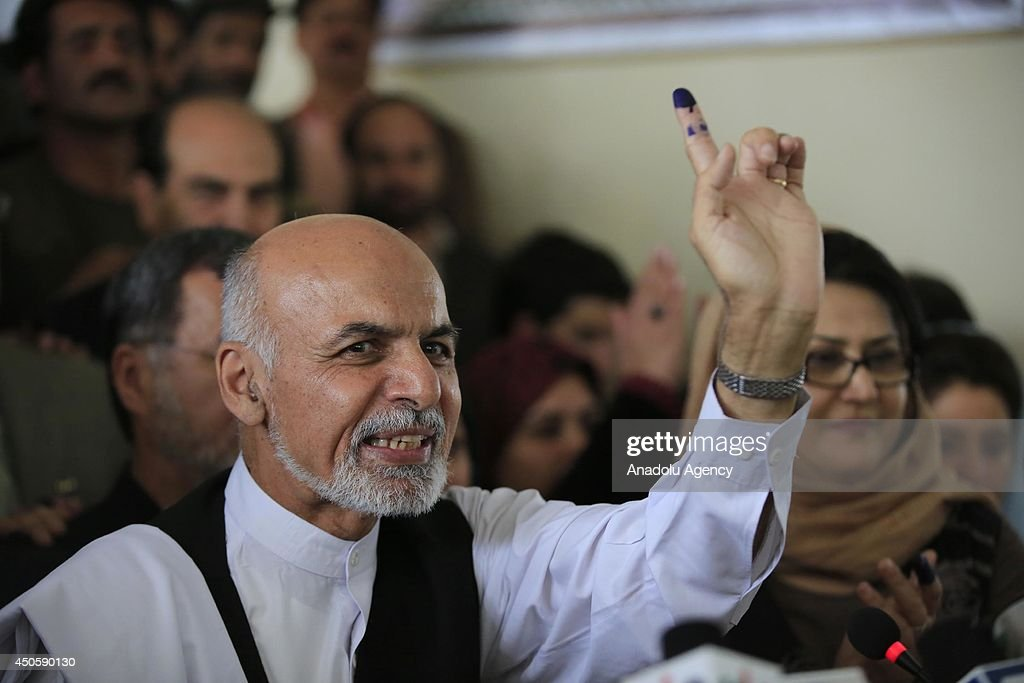 One of the president candidate former finance minister Ashraf Ghani Ahmadzai votes on second tour of the presidential election in a class of a high school in Kabul, Afghanistan on 14 June, 2014.