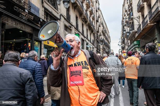 One of the protesters is seen shouting slogans with a megaphone during the demonstration Hundreds of retirees and pensioners have demonstrated in the...