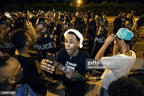 One of the protesters streams live video as they face off with Baton Rouge police July 8 2016 in Baton Rouge Louisiana Alton Sterling was shot by a...