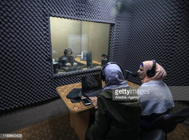 """One of the radio presenters visually handicapped Gada Zelmet and a woman are seen during a radio programme at Gaza's Radio Station """"Shems"""" in Gaza..."""