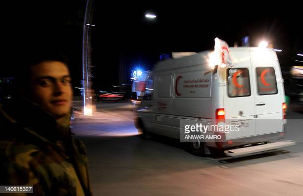 One of the Red Crescent ambulances that are carrying the remains of American reporter Marie Colvin and French photographer Remi Ochlik who were...