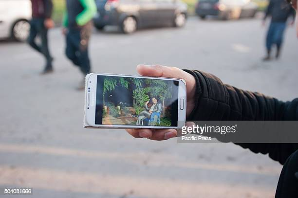 One of the refugees shows a picture from his life before having to flee This man is a Kurdish Christian from Northern Irak who was well known and...