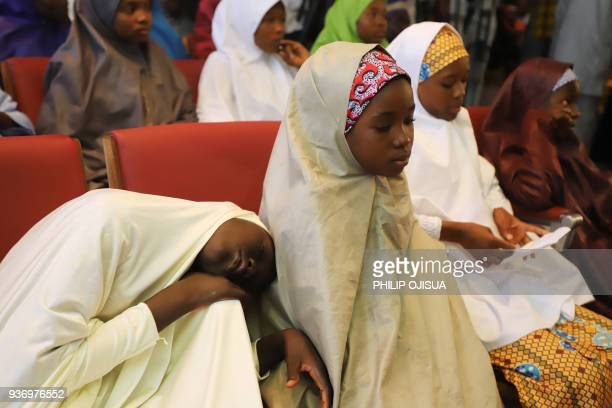 One of the released Nigerian school girls who were kidnapped by Boko Haram from their school in Dapchi in the northeastern state of Yobe falls asleep...