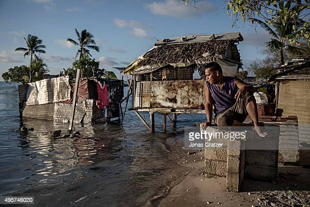 One of the residents of the village Eita is sitting and watching the ocean water slowly flood his village The people of Kiribati are under pressure...