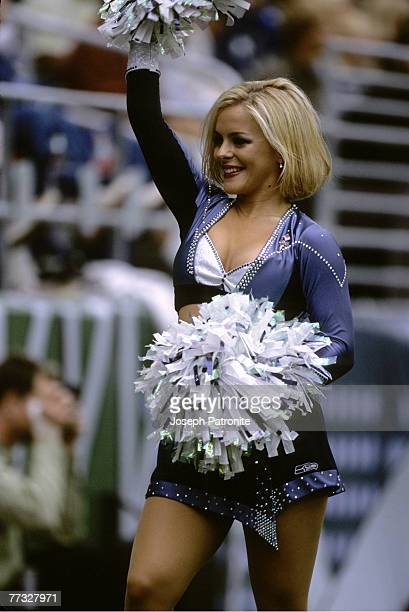 One of the Seattle Seahawks Sea Gals leads cheers during the Inaugural Game played at the new Seahawks Stadium on September 15 2002 in Seattle...
