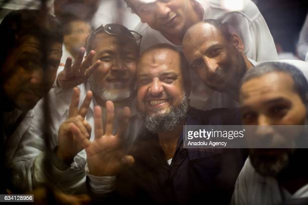 One of the senior political figures of the Muslim Brotherhood Mohamed Al-Beltagy gestures during a trial led by Judge Hassan Fareed over dispursing...