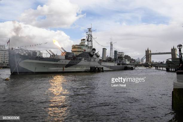 One of the six inch guns on HMS Belfast is fired during a sixgun salute to mark its 80th anniversary on March 16 2018 in London England The warship...