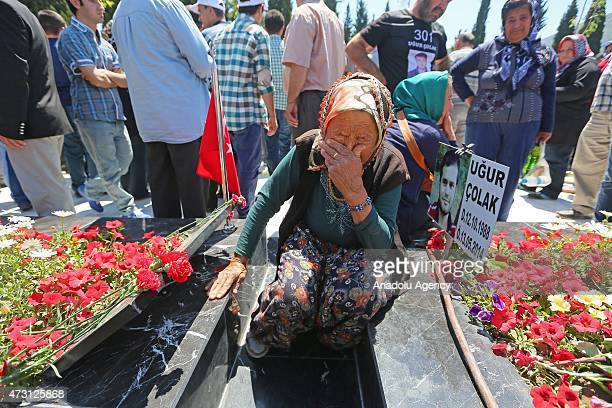 One of the Soma mine disaster victim Ugur Colak's 80-year-old grandmother mourns over his grave at the cemetery in the Turkish town of Soma in...