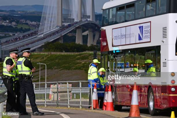 One of the special buses taking people to the start of the public walk across the new Queensferry Crossing road bridge over the Forth Estuary in a...