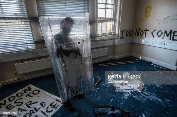 One of the squatters with a riot shield found inside the building on March 22, 2021 in London, England. Activists have occupied the former Clapham...