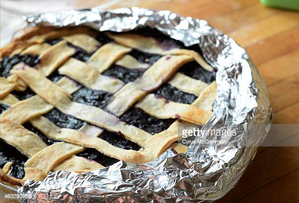 One of the ten secrets to making a really good pie is to line folded aluminium foil around the edge of the crust before baking the pie Writer John...