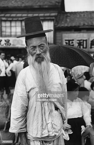 One of the thousands of refugees in Taejon from the Korean War Original Publication Picture Post 5086 War In Korea pub 1950