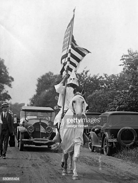 One of the thousands of robed masked Klansmen parading at Long Branch J St at the giant celebration of Independence Day July 4 by the KKK