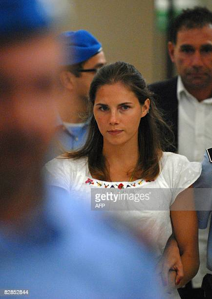 One of the three suspects in the murder of British student Meredith Kercher Amanda Knox from the US is escorted by police upon her arrival at a court...