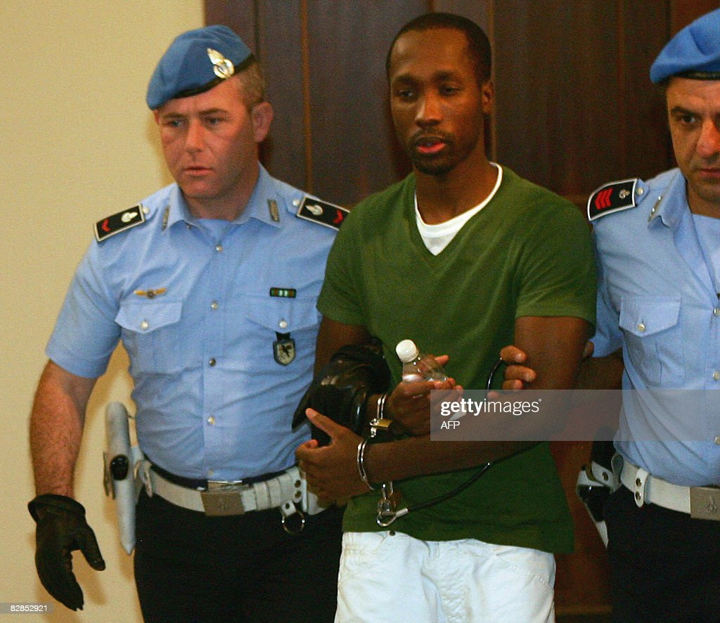 One of the three suspects in the murder : News Photo