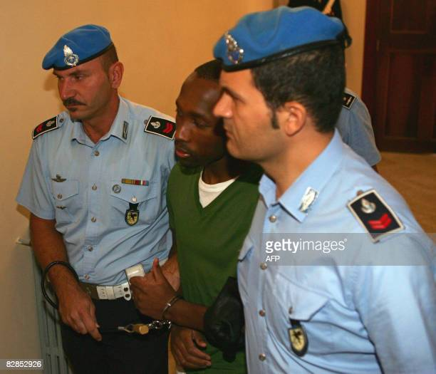 One of the three suspects in the murder of British student Meredith Kercher Ivorian national Rudy Hermann Guede is escorted by police upon his...