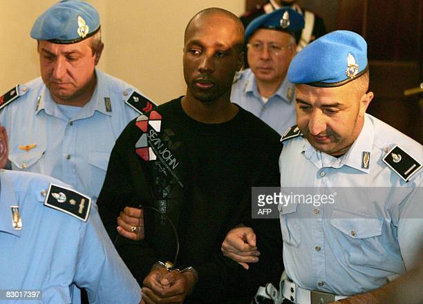 One of the three suspects in the murder of British student Meredith Kercher Rudy Guede from the Ivory Coast is escorted by police upon his arrival at...