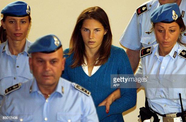 One of the three suspects in the murder of British student Meredith Kercher, Amanda Knox from the US , is escorted by police upon her arrival at a...