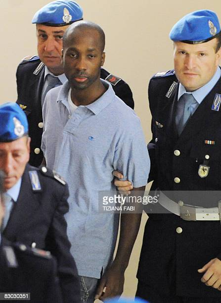 One of the three suspects in the murder of British student Meredith Kercher Rudy Guede from the Ivory Coast arrives at a court hearing in Perugia on...