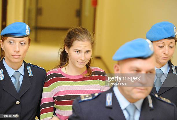 One of the three suspects in the murder of British student Meredith Kercher, Amanda Knox of the United States, leaves at a court hearing in Perugia...