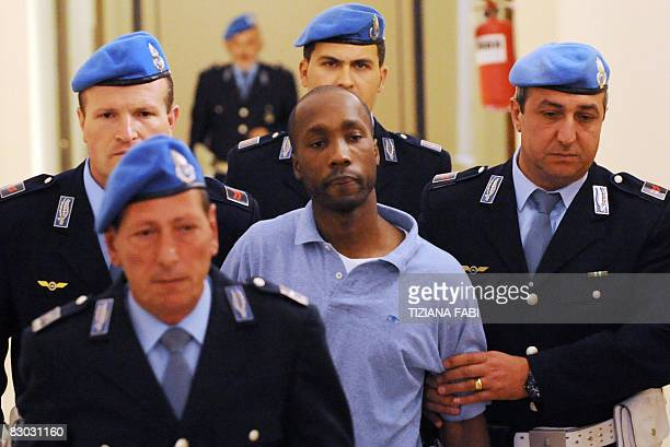 One of the three suspects in the murder of British student Meredith Kercher Rudy Guede from the Ivory Coast of the United States leaves at a court...