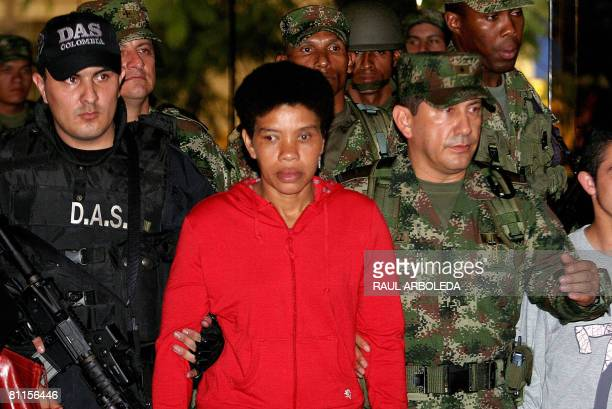 One of the topranking women leaders of Colombia's Marxist FARC guerrillas Nelly Avila Moreno alias Karina is escorted by soldiers on May 19 in...