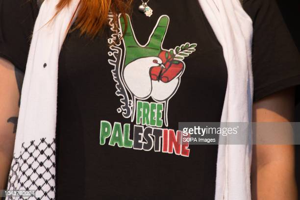 One of the translators seen with a Free Palestine shirt during the tour Ahed Tamimi on her European tour during the Spanish Communist festivities...