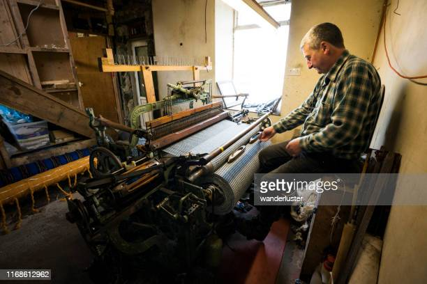 one of the tweed cloth weavers busy at work on the isle of lewis - tweed stock pictures, royalty-free photos & images